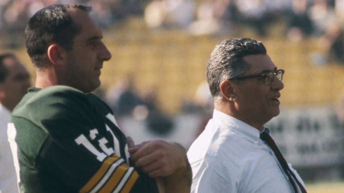 Green Bay Packers Hall of Fame head coach Vince Lombardi adn backup quarterback Zeke Bratkowski (12) watch the team warm up before Super Bowl I, a 35-10 victory over the Kansas City Chiefs on January 15, 1967, at the Los Angeles Memorial Coliseum in Los Angeles, California. (Photo by Vic Stein/Getty Images)