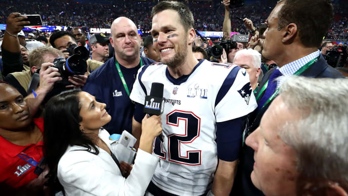 ATLANTA, GEORGIA - FEBRUARY 03:  Tom Brady #12 of the New England Patriots is interviewed after his teams 13-3 win over the Los Angeles Rams during Super Bowl LIII at Mercedes-Benz Stadium on February 03, 2019 in Atlanta, Georgia. (Photo by Al Bello/Getty Images)