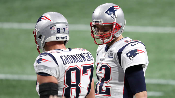 ATLANTA, GEORGIA - FEBRUARY 03:  Rob Gronkowski #87 and Tom Brady #12 of the New England Patriots speak to each other prior to Super Bowl LIII at Mercedes-Benz Stadium on February 03, 2019 in Atlanta, Georgia. (Photo by Patrick Smith/Getty Images)