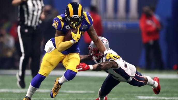 ATLANTA, GEORGIA - FEBRUARY 03:  Todd Gurley #30 of the Los Angeles Rams runs the ball against Jonathan Jones #31 of the New England Patriots in the second half during Super Bowl LIII at Mercedes-Benz Stadium on February 03, 2019 in Atlanta, Georgia. (Photo by Al Bello/Getty Images)