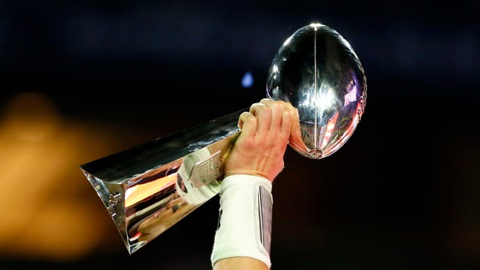GLENDALE, AZ - FEBRUARY 01:  Tom Brady #12 of the New England Patriots celebrates holding the Vince Lombardi Trophy after defeating the Seattle Seahawks during Super Bowl XLIX at University of Phoenix Stadium on February 1, 2015 in Glendale, Arizona. The Patriots defeated the Seahawks 28-24.  (Photo by Kevin C. Cox/Getty Images)