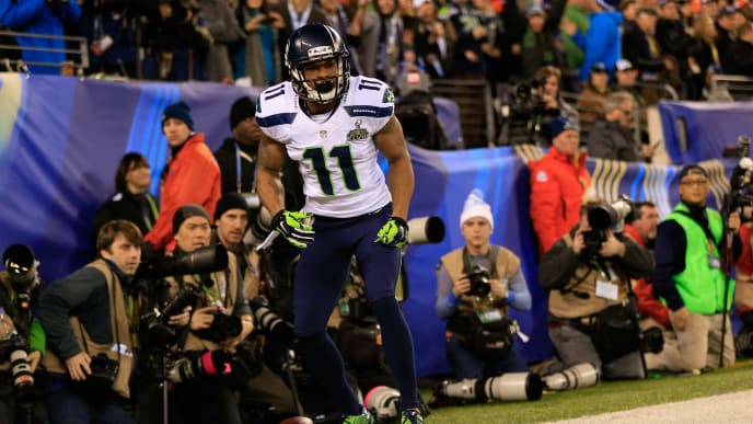 EAST RUTHERFORD, NJ - FEBRUARY 02:  Wide receiver Percy Harvin #11 of the Seattle Seahawks runs for 30 yards during Super Bowl XLVIII at MetLife Stadium against the Denver Broncos  on February 2, 2014 in East Rutherford, New Jersey.  (Photo by Jamie Squire/Getty Images)