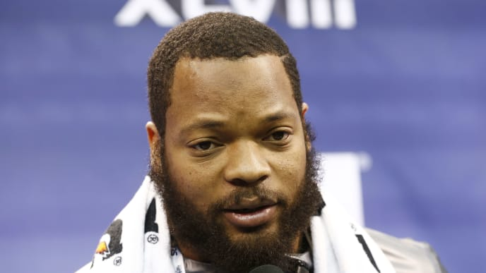 NEWARK, NJ - JANUARY 28:  Defensive end Michael Bennett #72 of the Seattle Seahawks speaks to the media during Super Bowl XLVIII Media Day at the Prudential Center on January 28, 2014 in Newark, New Jersey.  Super Bowl XLVIII will be played between the Seattle Seahawks and the Denver Broncos on February 2.  (Photo by Jeff Zelevansky/Getty Images)