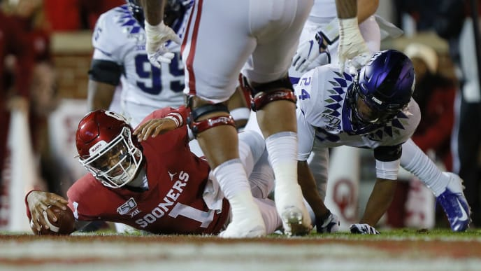 NORMAN, OK - NOVEMBER 23:  Quarterback Jalen Hurts #1 of the Oklahoma Sooners falls into the end zone for a 7-yard touchdown against cornerback Julius Lewis #24 of the TCU Horned Frogs in the first quarter on November 23, 2019 at Gaylord Family Oklahoma Memorial Stadium in Norman, Oklahoma.  (Photo by Brian Bahr/Getty Images)