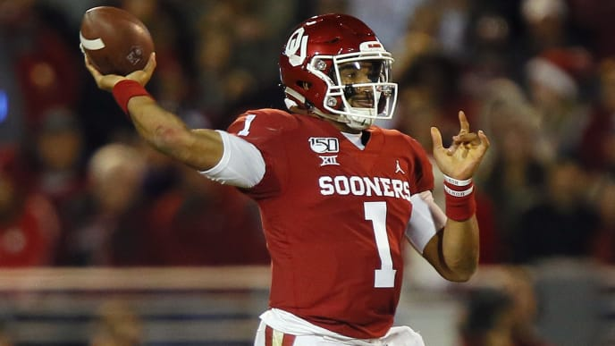 Jalen Hurts attempts a pass against TCU in Week 13.