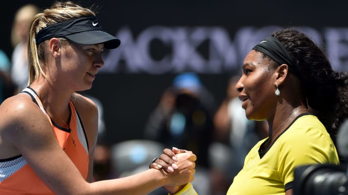 Serena Williams of the US (R) shakes hands with Russia's Maria Sharapova after winning their women's singles match on day nine of the 2016 Australian Open tennis tournament in Melbourne on January 26, 2016. AFP PHOTO / SAEED KHAN --  IMAGE RESTRICTED TO EDITORIAL USE - STRICTLY NO COMMERCIAL USE / AFP / SAEED KHAN        (Photo credit should read SAEED KHAN/AFP/Getty Images)