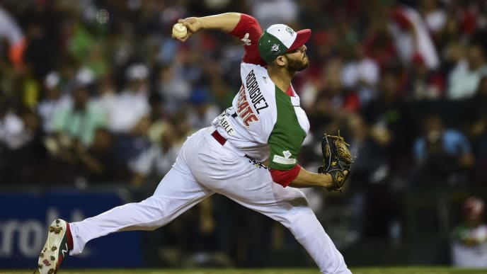 TOPSHOT - Pitcher Hector Rodriguez of Aguilas de Mexicali from Mexico throws against Alazanes de Granma from Cuba in the semifinals of Caribbean Baseball Series at the Tomateros stadium, in Culiacan, Sinaloa State, Mexico, on February 6, 2017. / AFP PHOTO / RONALDO SCHEMIDT        (Photo credit should read RONALDO SCHEMIDT/AFP via Getty Images)
