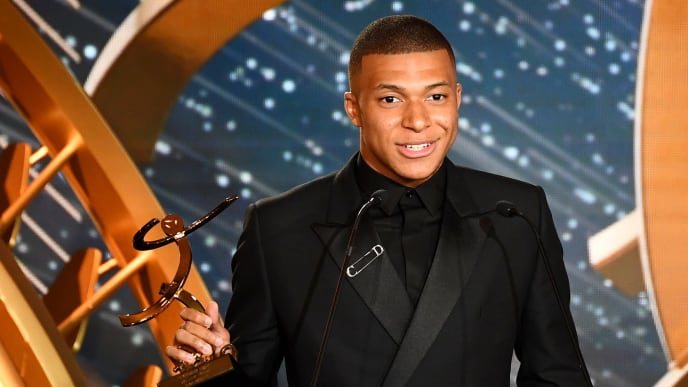 TOPSHOT - Paris Saint-Germain's French forward Kylian Mbappe delivers a speech after receiving the best hope player award, on May 19, 2019 in Paris, during the 28th edition of the UNFP (French National Professional Football players Union) trophy ceremony. (Photo by FRANCK FIFE / AFP)        (Photo credit should read FRANCK FIFE/AFP/Getty Images)