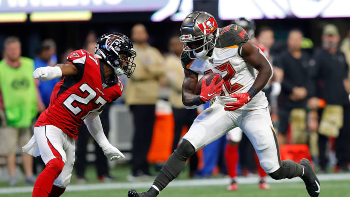 ATLANTA, GEORGIA - NOVEMBER 24:  Chris Godwin #12 of the Tampa Bay Buccaneers pulls in this reception as he is tackled by Damontae Kazee #27 of the Atlanta Falcons in the first half at Mercedes-Benz Stadium on November 24, 2019 in Atlanta, Georgia. (Photo by Kevin C. Cox/Getty Images)