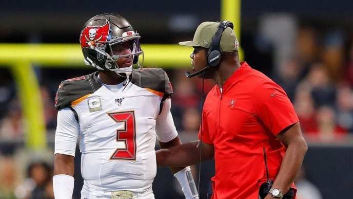 ATLANTA, GEORGIA - NOVEMBER 24:  Jameis Winston #3 and offensive coordinator Byron Leftwich of the Tampa Bay Buccaneers converse in the first half against the Atlanta Falcons at Mercedes-Benz Stadium on November 24, 2019 in Atlanta, Georgia. (Photo by Kevin C. Cox/Getty Images)