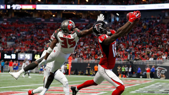 ATLANTA, GEORGIA - NOVEMBER 24:  Calvin Ridley #18 of the Atlanta Falcons fails to pull in this reception for a touchdown against Jamel Dean #35 of the Tampa Bay Buccaneers in the second half at Mercedes-Benz Stadium on November 24, 2019 in Atlanta, Georgia. (Photo by Kevin C. Cox/Getty Images)