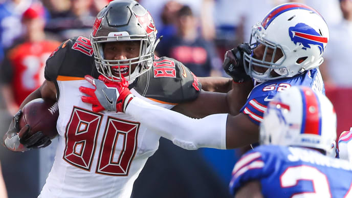 ORCHARD PARK, NY - OCTOBER 22:  O.J. Howard #80 of the Tampa Bay Buccaneers runs the ball as Preston Brown #52 of the Buffalo Bills attempts to tackle him during the third quarter of an NFL game on October 22, 2017 at New Era Field in Orchard Park, New York.  (Photo by Tom Szczerbowski/Getty Images)