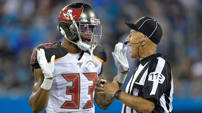 CHARLOTTE, NORTH CAROLINA - SEPTEMBER 12: Carlton Davis #33 of the Tampa Bay Buccaneers talks with official Tony Steratore #112 during their game against the Carolina Panthers at Bank of America Stadium on September 12, 2019 in Charlotte, North Carolina. The Buccaneers won 20-14. (Photo by Grant Halverson/Getty Images)