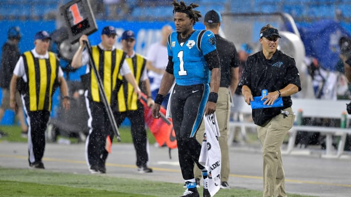 CHARLOTTE, NORTH CAROLINA - SEPTEMBER 12: Cam Newton #1 of the Carolina Panthers leaves the field during a weather delay during the first quarter of their game against the Tampa Bay Buccaneers at Bank of America Stadium on September 12, 2019 in Charlotte, North Carolina. (Photo by Grant Halverson/Getty Images)