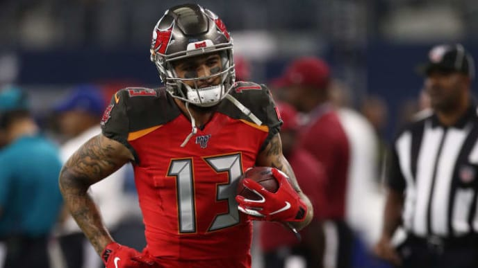 ARLINGTON, TEXAS - AUGUST 29:  Mike Evans #13 of the Tampa Bay Buccaneers warms up before a NFL preseason game at AT&T Stadium on August 29, 2019 in Arlington, Texas. (Photo by Ronald Martinez/Getty Images)