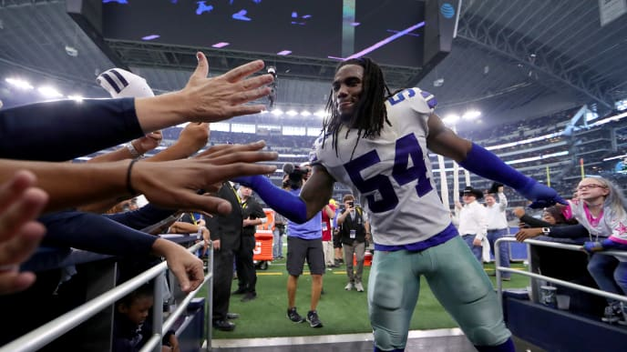 ARLINGTON, TEXAS - DECEMBER 23: Jaylon Smith #54 of the Dallas Cowboys walks off the field after the Dallas Cowboys beat the Tampa Bay Buccaneers 27-20 at AT&T Stadium on December 23, 2018 in Arlington, Texas. (Photo by Tom Pennington/Getty Images)