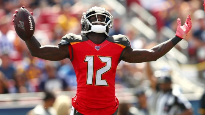 LOS ANGELES, CALIFORNIA - SEPTEMBER 29: Chris Godwin #12 of the Tampa Bay Buccaneers celebrates his run in the first quarter against the Los Angeles Rams at Los Angeles Memorial Coliseum on September 29, 2019 in Los Angeles, California. (Photo by Joe Scarnici/Getty Images)