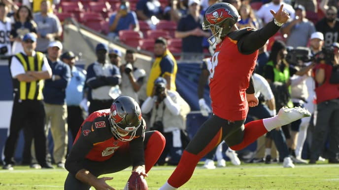 LOS ANGELES, CA - SEPTEMBER 29: Bradley Pinion #8 of the Tampa Bay Buccaneers holds the ball for Matt Gay #9 for a fieldgoal against the Los Angeles Rams at Los Angeles Memorial Coliseum on September 29, 2019 in Los Angeles, California. Tampa Bay won 55-40. (Photo by John McCoy/Getty Images)
