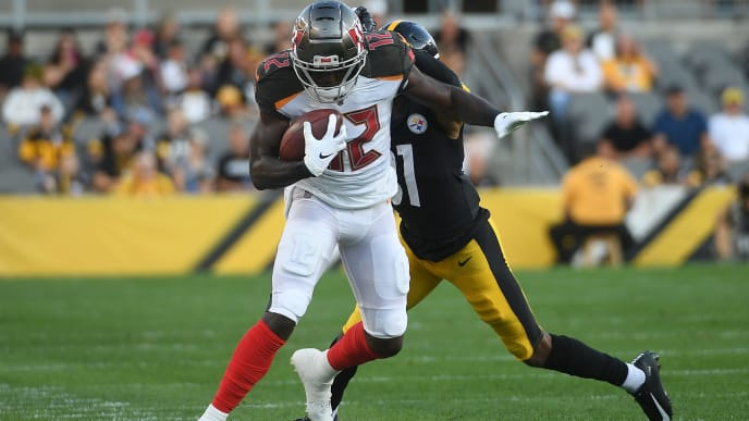 PITTSBURGH, PA - AUGUST 09: Chris Godwin #12 of the Tampa Bay Buccaneers is forced out of bounds after a catch by Justin Layne #31 of the Pittsburgh Steelers during the first half of a preseason game at Heinz Field on August 9, 2019 in Pittsburgh, Pennsylvania. (Photo by Justin Berl/Getty Images)