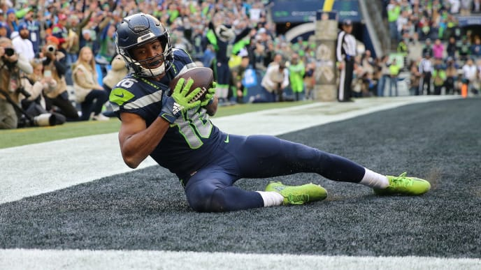 SEATTLE, WASHINGTON - NOVEMBER 03: Tyler Lockett #16 of the Seattle Seahawks scores a two yard touchdown against the Tampa Bay Buccaneers in the third quarter during their game at CenturyLink Field on November 03, 2019 in Seattle, Washington. (Photo by Abbie Parr/Getty Images)