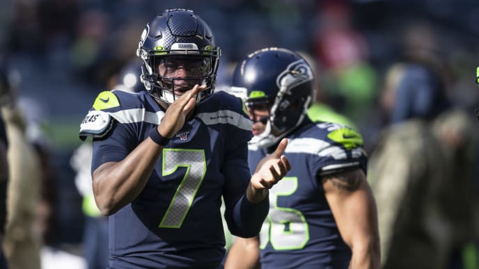 SEATTLE, WA - NOVEMBER 3: Quarterback Geno Smith #7 of the Seattle Seahawks cheers on teammates during warmups before a game against the Tampa Bay Buccaneers at CenturyLink Field on November 3, 2019 in Seattle, Washington. The Seahawks won 40-34 in overtime. (Photo by Stephen Brashear/Getty Images)