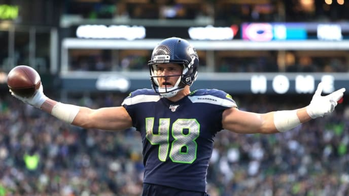 SEATTLE, WASHINGTON - NOVEMBER 03: Jacob Hollister #48 of the Seattle Seahawks celebrates after scoring the game-winning touchdown in overtime against the Tampa Bay Buccaneers during a game at CenturyLink Field on November 03, 2019 in Seattle, Washington. (Photo by Abbie Parr/Getty Images)
