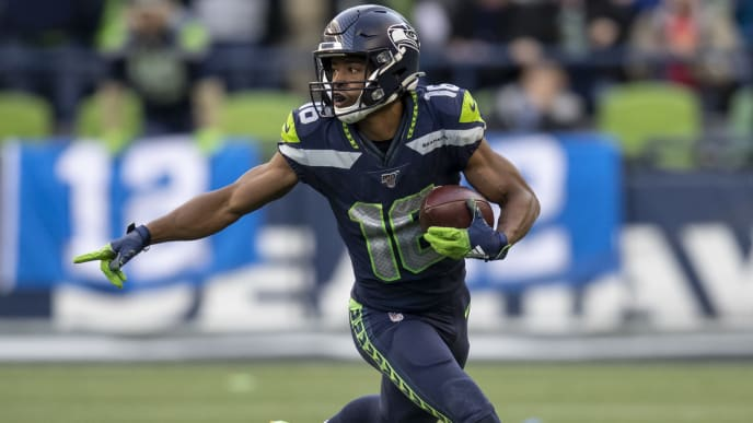 SEATTLE, WA - NOVEMBER 3: Tyler Lockett #16 of the Seattle Seahawks returns a punt during a game against the Tampa Bay Buccaneers at CenturyLink Field on November 3, 2019 in Seattle, Washington. The Seahawks won 40-34 in overtime. (Photo by Stephen Brashear/Getty Images)