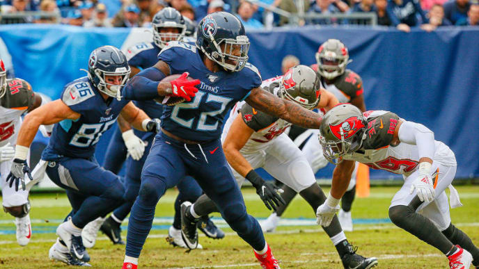 NASHVILLE, TENNESSEE - OCTOBER 27: Derrick Henry #22 of the Tennessee Titans stiff arms Andrew Adams #39 of the Tampa Bay Buccaneers during the first half at Nissan Stadium on October 27, 2019 in Nashville, Tennessee. (Photo by Frederick Breedon/Getty Images)
