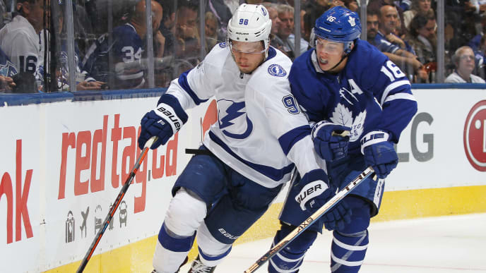 TORONTO, ON - OCTOBER 10:  Mikhail Sergchev #98 of the Tampa Bay Lightning skates from a checking Mitchell Marner #16 of the Toronto Maple Leafs during an NHL game at Scotiabank Arena on October 10, 2019 in Toronto, Ontario, Canada. The Lightning defeated the Maple Leafs 7-3. (Photo by Claus Andersen/Getty Images)
