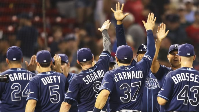 BOSTON, MA - JULY 30:  The Tampa Bay Rays react after a victory over the Boston Red Sox at Fenway Park on July 30, 2019 in Boston, Massachusetts.  (Photo by Adam Glanzman/Getty Images)