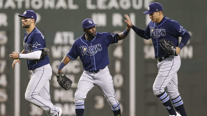 BOSTON, MA - JULY 31:  Austin Meadows #17, Kevin Kiermaier #39 and Avisail Garcia #24 of the Tampa Bay Rays react after a victory over the Boston Red Sox at Fenway Park on July 31, 2019 in Boston, Massachusetts.  (Photo by Adam Glanzman/Getty Images)