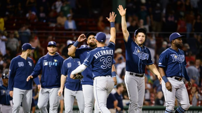 BOSTON, MA - AUGUST 1: Kevin Kiermaier #39 celebrates with teammate Travis d'Arnaud #37 of the Tampa Bay Rays after beating the Boston Red Sox at Fenway Park on August 1, 2019 in Boston, Massachusetts. (Photo by Kathryn Riley/Getty Images)