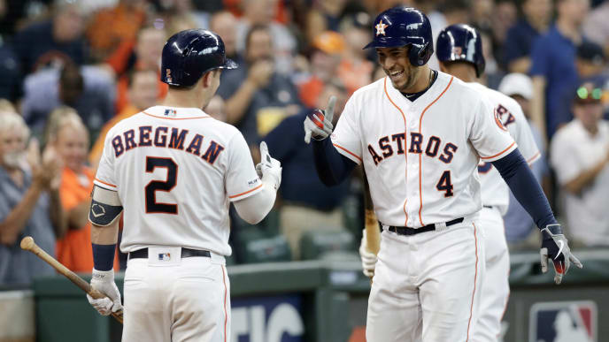 HOUSTON, TX - AUGUST 29:  George Springer #4 of the Houston Astros is congratulated by Alex Bregman #2 after a home run in the third inning against the Tampa Bay Rays at Minute Maid Park on August 29, 2019 in Houston, Texas.  (Photo by Tim Warner/Getty Images)