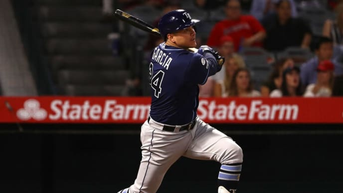 ANAHEIM, CALIFORNIA - SEPTEMBER 13: Avisail Garcia #24 of the Tampa Bay Rays watches his hit to deep right field go for a two-run double during the eighth inning of the MLB game against the Los Angeles Angels at Angel Stadium of Anaheim on September 13, 2019 in Anaheim, California. The Rays defeated the Angels 11-4. (Photo by Victor Decolongon/Getty Images)