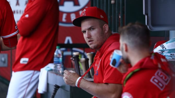 ANAHEIM, CALIFORNIA - SEPTEMBER 14: Mike Trout #27 of the Los Angeles Angels looks on from the dugout during the first inning of the MLB game between the Tampa Bay Rays and the Los Angeles Angels at Angel Stadium of Anaheim on September 14, 2019 in Anaheim, California. The Rays defeated the Angels 3-1.  (Photo by Victor Decolongon/Getty Images)