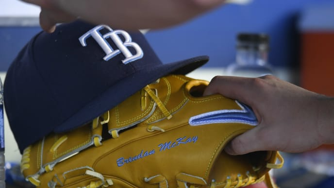 LOS ANGELES, CA - SEPTEMBER 18: A cap and glove belonging to Brendan McKay #49 of the Tampa Bay Rays during a game against the Los Angeles Dodgers at Dodger Stadium on September 18, 2019 in Los Angeles, California. The Rays won in the 11th inning 8-7. (Photo by John McCoy/Getty Images)