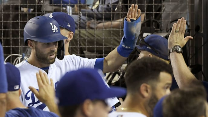 LOS ANGELES, CA - SEPTEMBER 18: Chris Taylor #3 of the Los Angeles Dodgers is congratulated after scoring a run on a passed ball by Travis d'Arnaud #37 of the Tampa Bay Rays in the sixth inning at Dodger Stadium on September 18, 2019 in Los Angeles, California. (Photo by John McCoy/Getty Images)