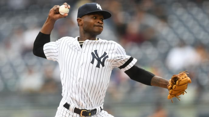 NEW YORK, NEW YORK - JULY 18: Domingo German #55 of the New York Yankees pitches during the first inning of game one of a doubleheader against the Tampa Bay Rays at Yankee Stadium on July 18, 2019 in the Bronx borough of New York City. (Photo by Sarah Stier/Getty Images)