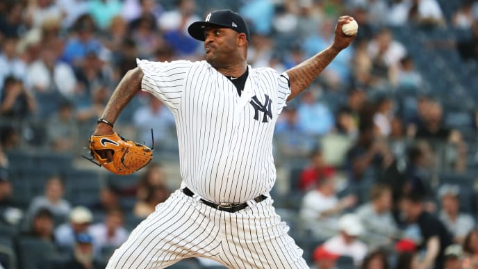 NEW YORK, NEW YORK - JULY 16:  CC Sabathia #52 of the New York Yankees pitches against the Tampa Bay Rays during their at Yankee Stadium on July 16, 2019 in New York City. (Photo by Al Bello/Getty Images)
