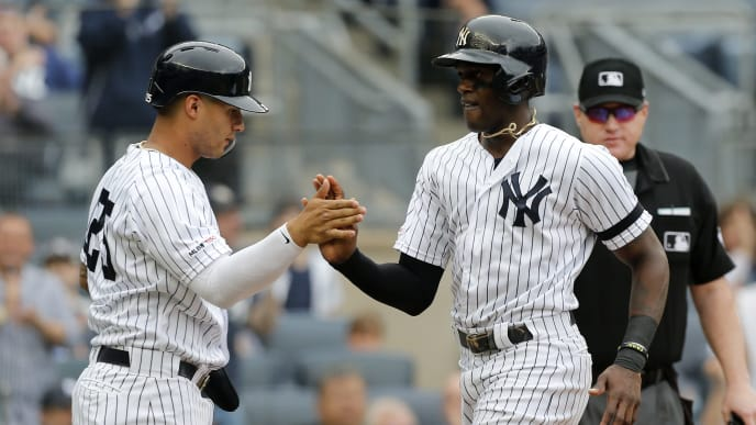 NEW YORK, NEW YORK - JUNE 19:   Cameron Maybin #38 and Gleyber Torres #25 of the New York Yankees celebrate after both scored during the first inning against the Tampa Bay Rays at Yankee Stadium on June 19, 2019 in New York City. (Photo by Jim McIsaac/Getty Images)