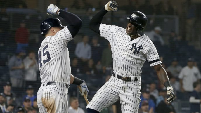 NEW YORK, NEW YORK - JUNE 18:   Cameron Maybin #38 of the New York Yankees celebrates his seventh inning home run against the Tampa Bay Rays with teammate Luke Voit #45 at Yankee Stadium on June 18, 2019 in New York City. (Photo by Jim McIsaac/Getty Images)