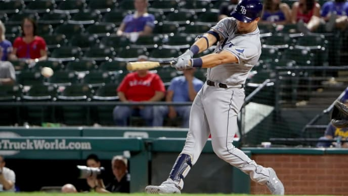 ARLINGTON, TEXAS - SEPTEMBER 11: Nate Lowe #35 of the Tampa Bay Rays hits a single against the Texas Rangers in the top of the eighth inning at Globe Life Park in Arlington on September 11, 2019 in Arlington, Texas. (Photo by Tom Pennington/Getty Images)
