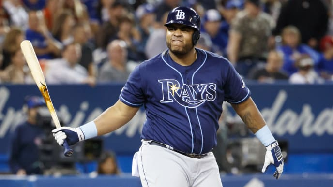TORONTO, ON - SEPTEMBER 28: Jesus Aguilar #21 of the Tampa Bay Rays reacts to a strike call on him during the sixth inning of their MLB game against the Toronto Blue Jays at Rogers Centre on September 28, 2019 in Toronto, Canada. (Photo by Cole Burston/Getty Images)
