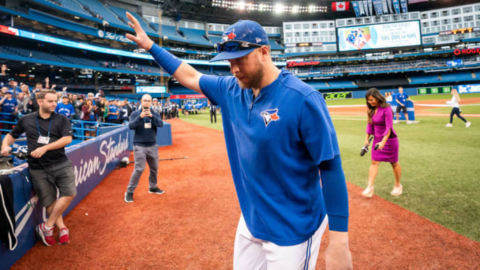 TORONTO, ONTARIO - SEPTEMBER 29: Justin Smoak #14 of the Toronto Blue Jays walks off the field after his team defeated the Tampa Bay Rays in the final game of the season in their MLB game at the Rogers Centre on September 29, 2019 in Toronto, Canada. (Photo by Mark Blinch/Getty Images)