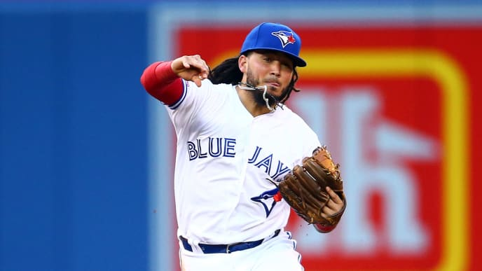 TORONTO, ON - JULY 26:  Freddy Galvis #16 of the Toronto Blue Jays throws to first base to get Matt Duffy #5 of the Tampa Bay Rays out in the fourth inning during a MLB game at Rogers Centre on July 26, 2019 in Toronto, Canada.  (Photo by Vaughn Ridley/Getty Images)