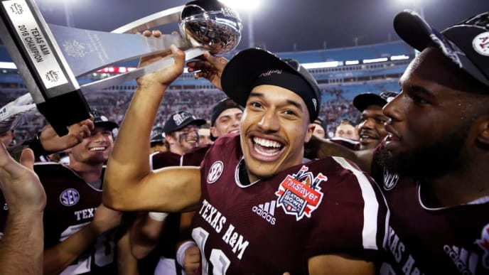 JACKSONVILLE, FL - DECEMBER 31: Kellen Mond #11 of the Texas A&M Aggies holds the championship trophy after a win against the North Carolina State Wolfpack in the TaxSlayer Gator Bowl at TIAA Bank Field on December 31, 2018 in Jacksonville, Florida. Texas A&M won 52-13. (Photo by Joe Robbins/Getty Images)