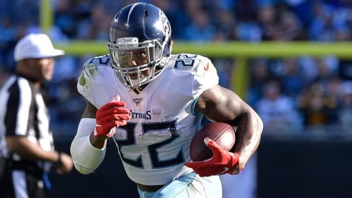 CHARLOTTE, NORTH CAROLINA - NOVEMBER 03: Derrick Henry #22 of the Tennessee Titans runs against the Carolina Panthers during their game at Bank of America Stadium on November 03, 2019 in Charlotte, North Carolina. The Panthers won 30-20. (Photo by Grant Halverson/Getty Images)