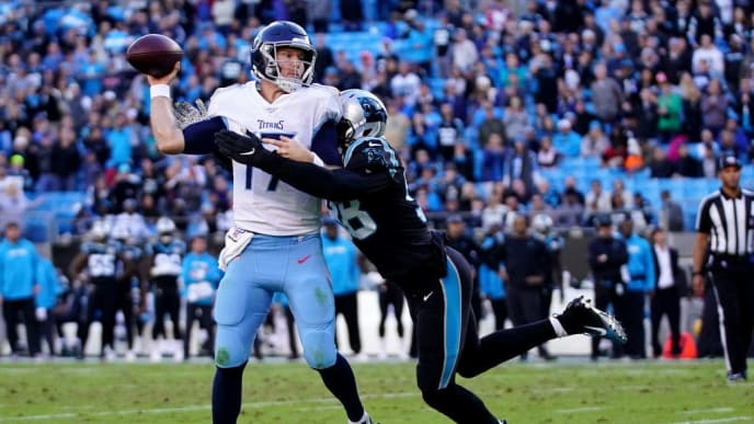 CHARLOTTE, NORTH CAROLINA - NOVEMBER 03: Ryan Tannehill #17 of the Tennessee Titans is pressured by Marquis Haynes #98 of the Carolina Panthers in the fourth quarter during their game at Bank of America Stadium on November 03, 2019 in Charlotte, North Carolina. (Photo by Jacob Kupferman/Getty Images)