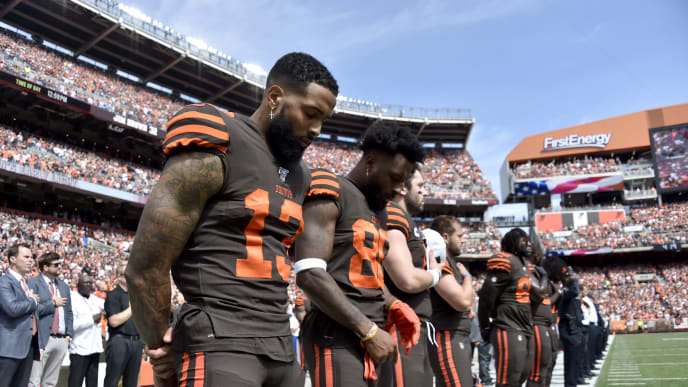 CLEVELAND, OHIO - SEPTEMBER 08: Wide receiver Odell Beckham #13 (L) and teammate Jarvis Landry #80 of the Cleveland Browns stand on the field during the national anthem before playing in the game against the Tennessee Titans at FirstEnergy Stadium on September 08, 2019 in Cleveland, Ohio. (Photo by Jason Miller/Getty Images)