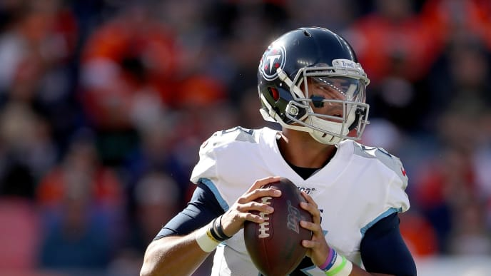 DENVER, COLORADO - OCTOBER 13: Quarterback Marcus Mariota #8 of the Tennessee Titans throws against the Denver Broncos in the second quarter at Broncos Stadium at Mile High on October 13, 2019 in Denver, Colorado. (Photo by Matthew Stockman/Getty Images)